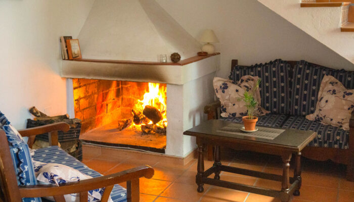 Cosy corner with open fireplace in Casa Vegana