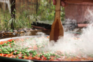 Homemade paella with fresh ingredients and prepared in the outdoor kitchen