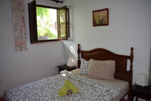 Bedroom in Cottage La Solina with double bed and view of the garden