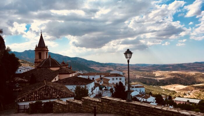 View over Zahara de la Sierra with church steeple and wrought iron lamppost