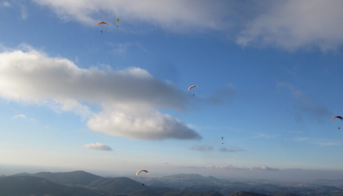 Colorful sky of parachutes above Algodonales