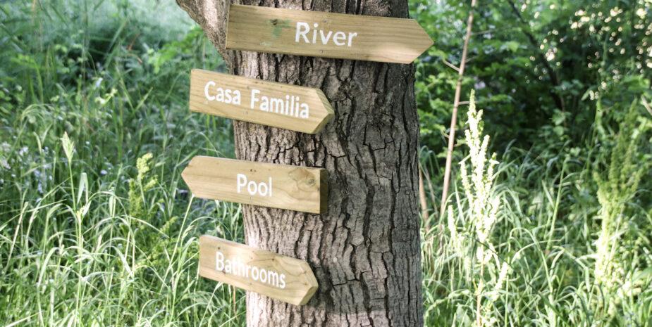 Handmade signs guide you around the Finca