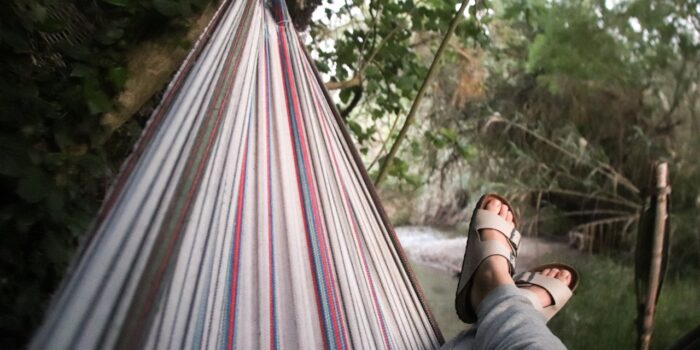 Listen to the splashing water while relaxing in a hammock by the stream